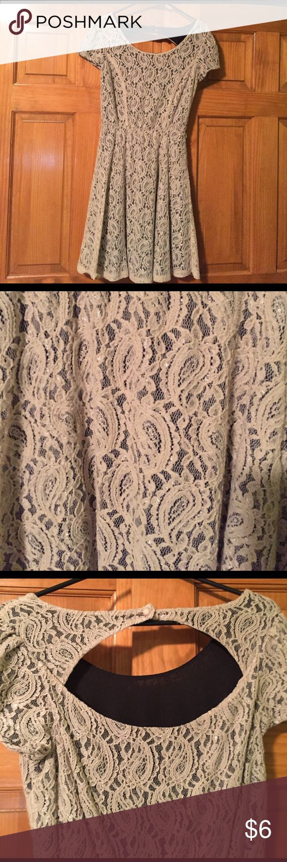 Tan lace dress lined in black Great condition.   No longer have belt but would not have to have.  Purchased at Maurice's.  Size medium Dresses Mini