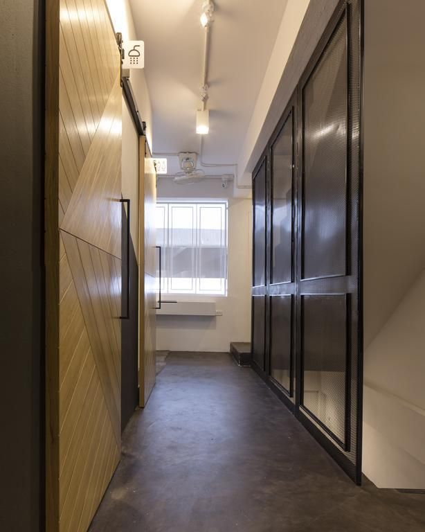 Bed One Block Hostel Design - showers. This slimlined hostel design in Bangkok, Thailand is genius!