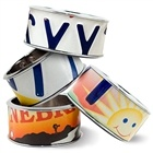 Statement bangles made from recycled authentic US state license plates. Each one is unique!