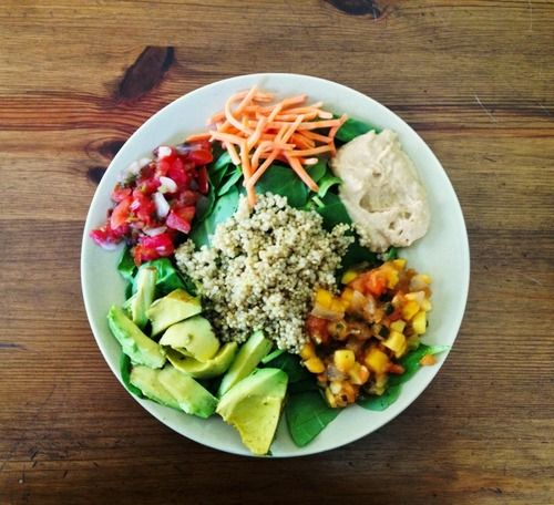 Spinach with quinoa, carrots, avocado, hummus, pico de gallo, and mango papaya salsa.