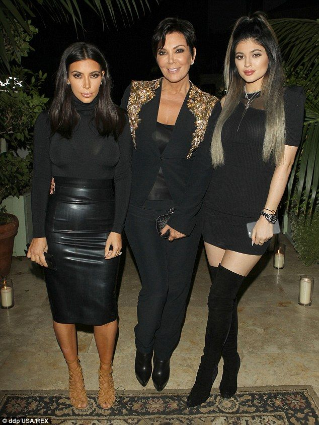 Acceptance: Bruce's family has been allowed to get slowly get used to his changing looks, People reported; pictured are Kim, Kris and Kylie on November 9, 2014