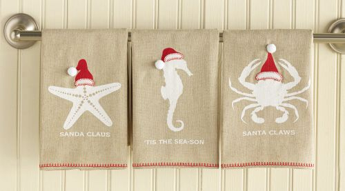 "SEAson Greetings Towel. Add a whimsical beach element to the bath or kitchen. Linen hand towel with blanket stitching detail and santa hat applique. ""Sanda Claus"" Starfish; ""Tis the Sea-Son"" Seahorse or ""Santa Claws"" Crab."