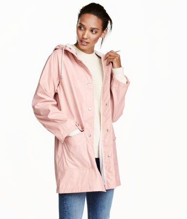 Light pink. Raincoat in water-repellent functional fabric with welded seams. Drawstring hood, snap fasteners at front, and front pockets with flap and snap