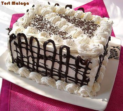 Tort Malaga ~ Culorile din farfurie.ro Blat de tort+Bezea- copt Impreuna 1H Taie blatol in doua + un strat subtire de ciocolata topita  peste bezea ( ca bariera) CREMA: Frisca+ Budinca +Gelatina+ stafide... ORNAT: Frisca (+ gelatina) si ciocolata ...