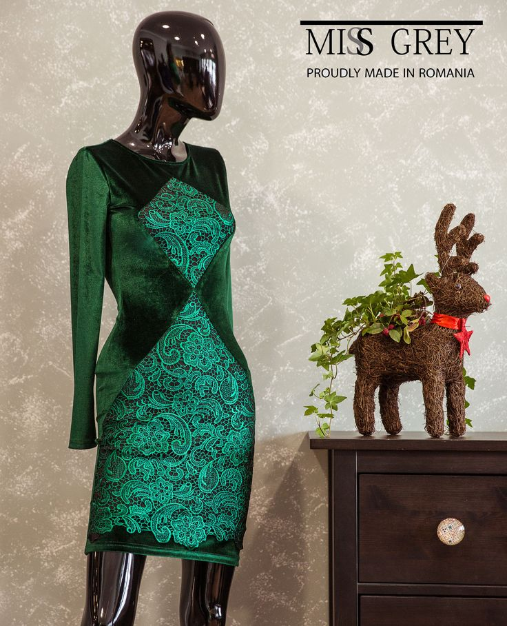 A lovely emerald elegant dress made from velvet and lace.