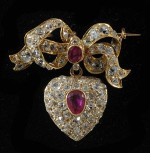 Victorian gold bow and heart brooch with Burmese rubies and fine old cut diamonds 1880c from John Joseph Brooches via john-joseph.co.uk