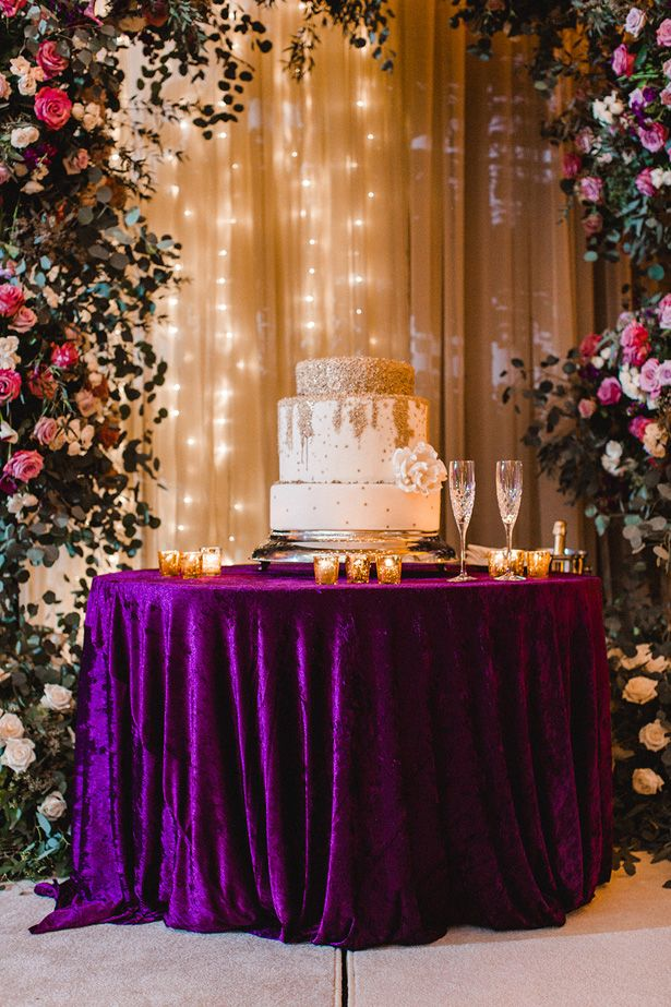 A Luxury Wedding Filled With Whimsical And Romantic Florals Wedding Cake Table Decorations Wedding Cake Table Decorations Purple Purple And Gold Wedding