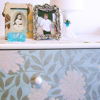 I would never have thought to wallpaper the front of a dresser to give it a new look...something i will have to try!