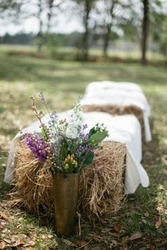 Seating atop hay bales covered with cloth for an outdoor seating