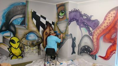 Graphitti artist 'Ants' at work in what was the Childrens Library 'Kidzone' at Rotorua District Library