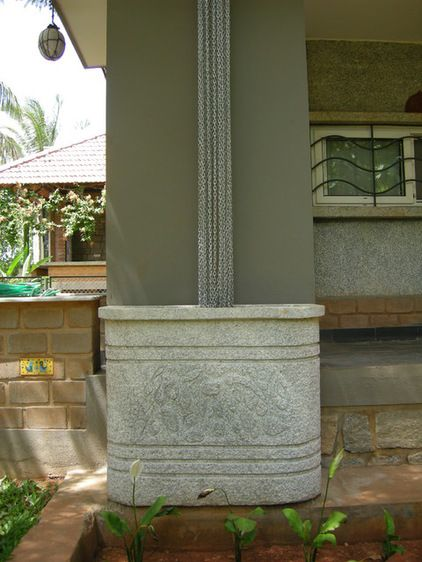 Show it off. This elegant rain chain/stone barrel combination doubles as a sculptural element in the garden.