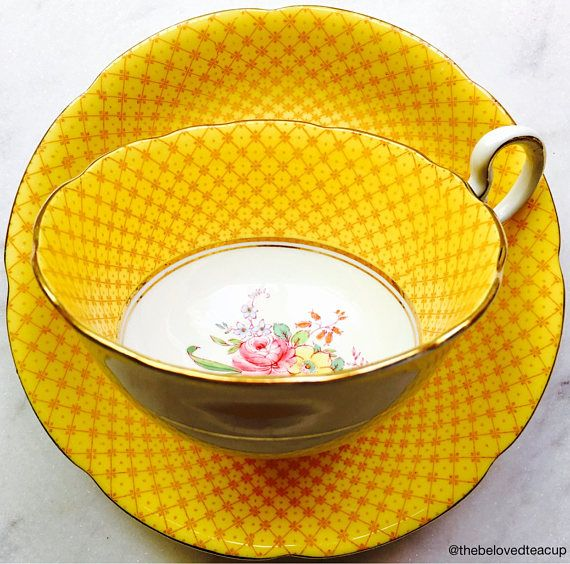 Incredible century old Grafton China yellow basketweave tea cup and saucer featuring a sweet pink rose bouquet focal design. This set dates between 1900 and 1913, according to the backstamp. It has no chips or cracks and only minor crazing. The paint is still vivid and bright and the