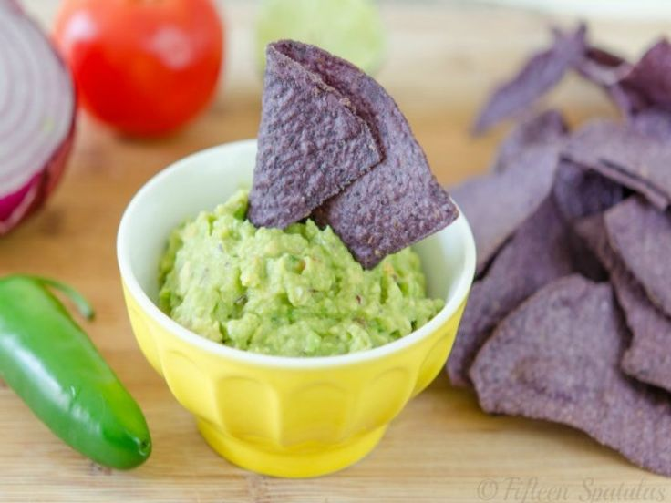 Easy guacamole recipe with avocado tomatoes red onion jalapeno and lime. #ifoodtv