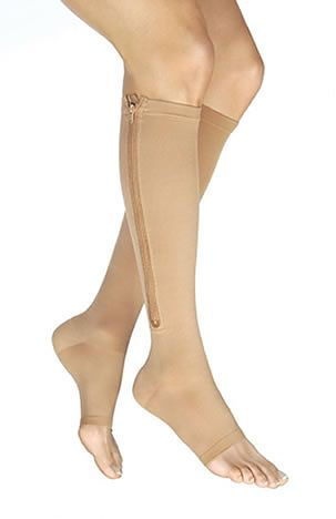 Zipped up compression sock looks so easy. Jobst Vairox 30-40 mmHg Open Toe Knee Highs with Zipper   These state-of-the-art edema compression stockings have been designed with a firm compression level, and a zipper for ease in applying wound dressings, for those treating ulcers.   These unisex medical compression stockings are also used for treating chronic venous insufficiency, deep vein thrombosis, and severe varicose veins.