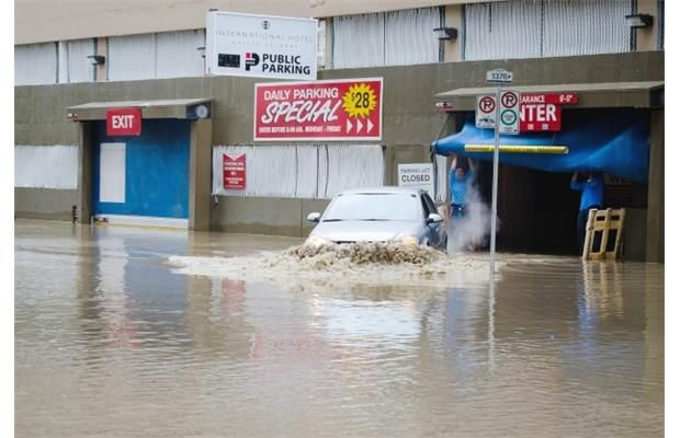A car leaves a flooded parkade in downtown Calgary on Friday, June 21, 2013. Photograph by:  Read more: http://www.calgaryherald.com/Gallery+Pictures+from+flood+ravaged+Alberta/8559569/story.html#ixzz2Wtc26Bde