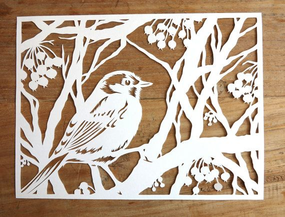 Lovely little bird warm in his little feather coat, enjoys sitting in his berry-filled winter tree. This one of a kind work of art will put a smile on your face, even in the greyest winter days. NEW: This design is available now as a high quality lasercut as well! Check it out here: http://etsy.me/1RznVyz I love nature; birds, trees... I start my papercut by looking in several books and mixing several pictures with my own imagination. When Im finally totally happy with the design, I can…