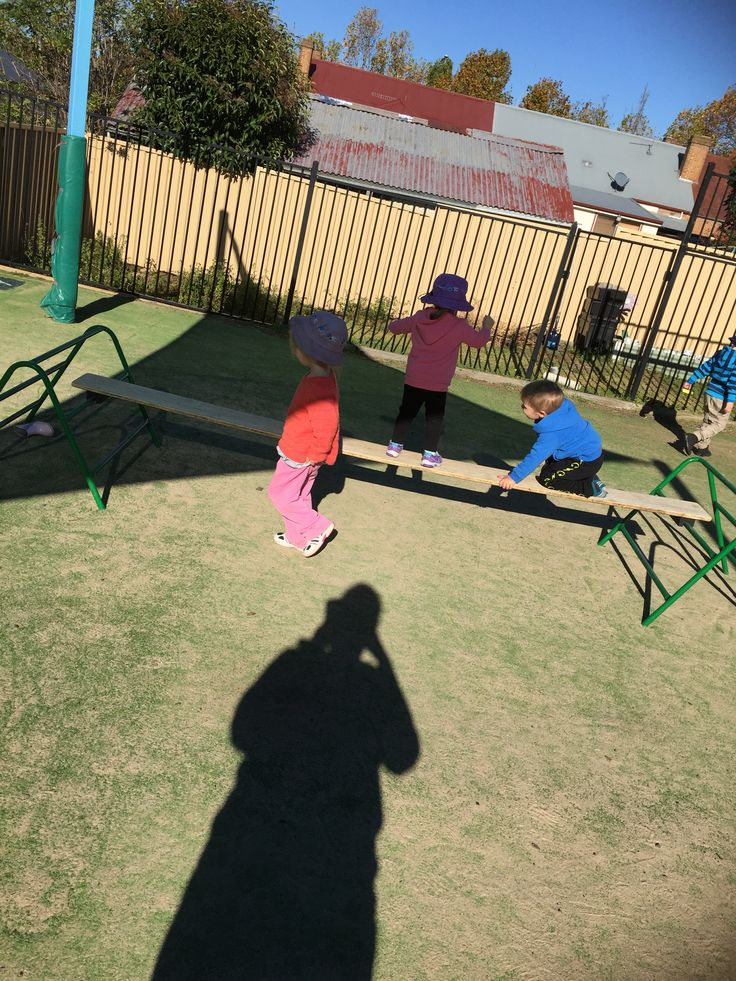 "Walk on the bridge. This activity encourages children to crawl along the narrow board to reach other side.This activity started with me assisting children to walk the ""bridge"" and when child felt confident enough, I encouraged them to crawl without any help.I provided encouragement for children and praised them for their bravery."