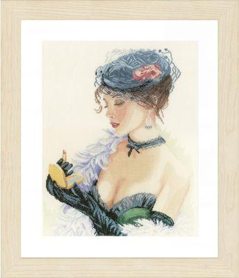 """Varenr. LPN-0154332 Broderi pakning - Lady med læbestift Str. 33 x 45 cm. Broderes med korssting på Hør med 12 tr. pr. cm. / 30"""" efter tællemønster. Pakken indeholder instruktion, stof, mønster, garn og en nål."""