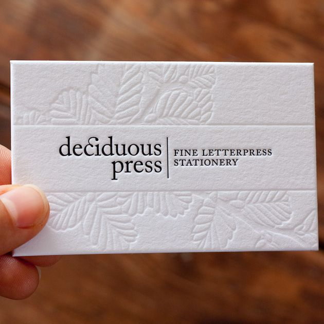 debossed business cards , like smooth center stripe, also like name on side, line then interior design on other side