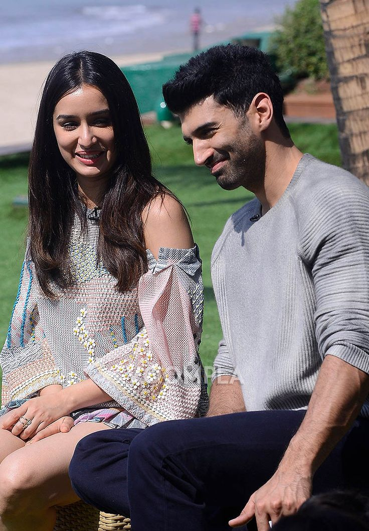 Candid pic of Shraddha and Aditya... how cute do they look together?? via Voompla.com