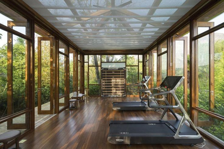 Luxury Fitness Design | natural air-flow, greenery, wood gym flooring, Technogym Personal fitness equipment