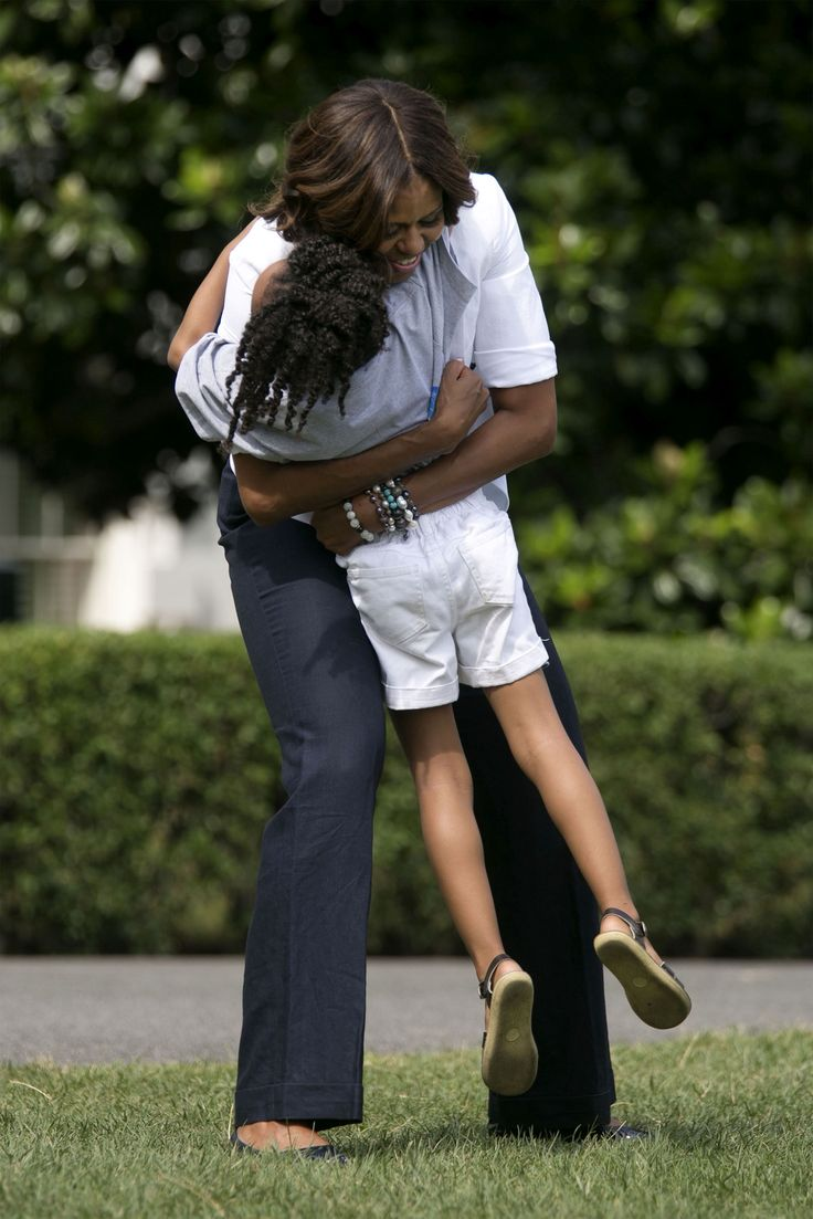 President Obama may be the Commander-in-chief. But First Lady Michelle Obama is the hgger-in-chief.