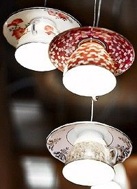 tea cups! [ very cool. I like this trend, I saw a drum set turned into a hanging light set & kitchen pots, too. And I thought I was so clever when I study a lamp shade frame under an old tennis skirt in my tennis themed office years ago. I need to work a little harder at my crafting ;-) ]