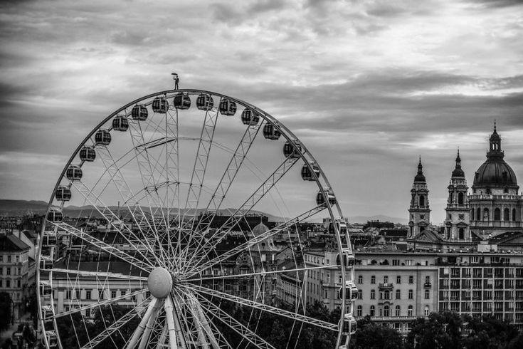 I Captured A Mysterious Umbrella Man Balancing On Budapest's Famous Sights | Bored Panda