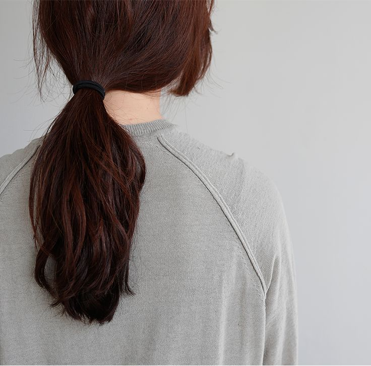 Slightly mussed, low, ponytail, natural texture, shortest layers loose framing face. | Death by Elocution