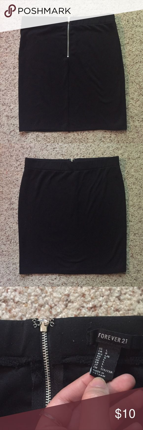 Forever21 Black Skirt Stretchy, tight fit. Says large but fits like a small or medium. Zipper and clasp in the back. Forever 21 Skirts Mini