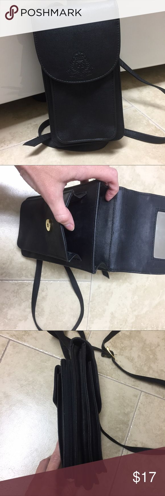 Tandem Bags Crossbody Travel Bag Purse Handbag Excellent condition. Individual pockets for money, passport, phone and sunglasses. Great way to stay organized when you travel. Black faux leather. Adjustable strap.  Measures approx 9 x 5. Tandem Bags Crossbody Bags