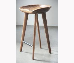 Bassam Fellows walnut tractor bar stool.