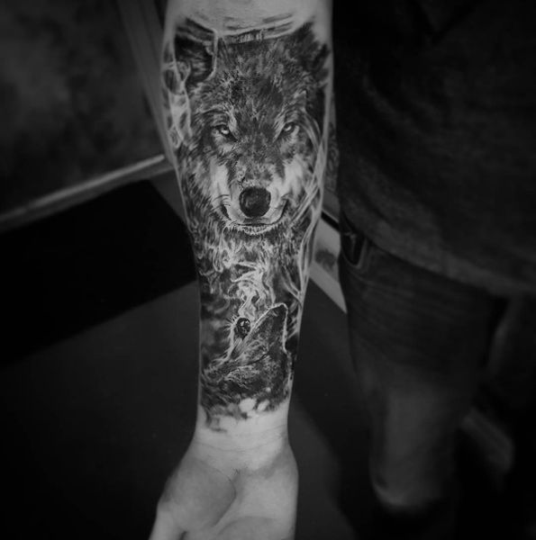 Smokey wolf tattoo on forearm by Odalisque Studios