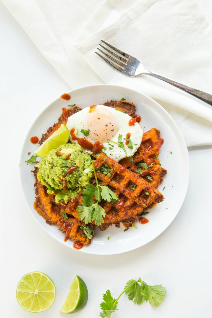Have a hardy breakfast with these Sweet Potato Waffles topped with guacamole and a sunny side up egg! | healthy recipe ideas @xhealthyrecipex |