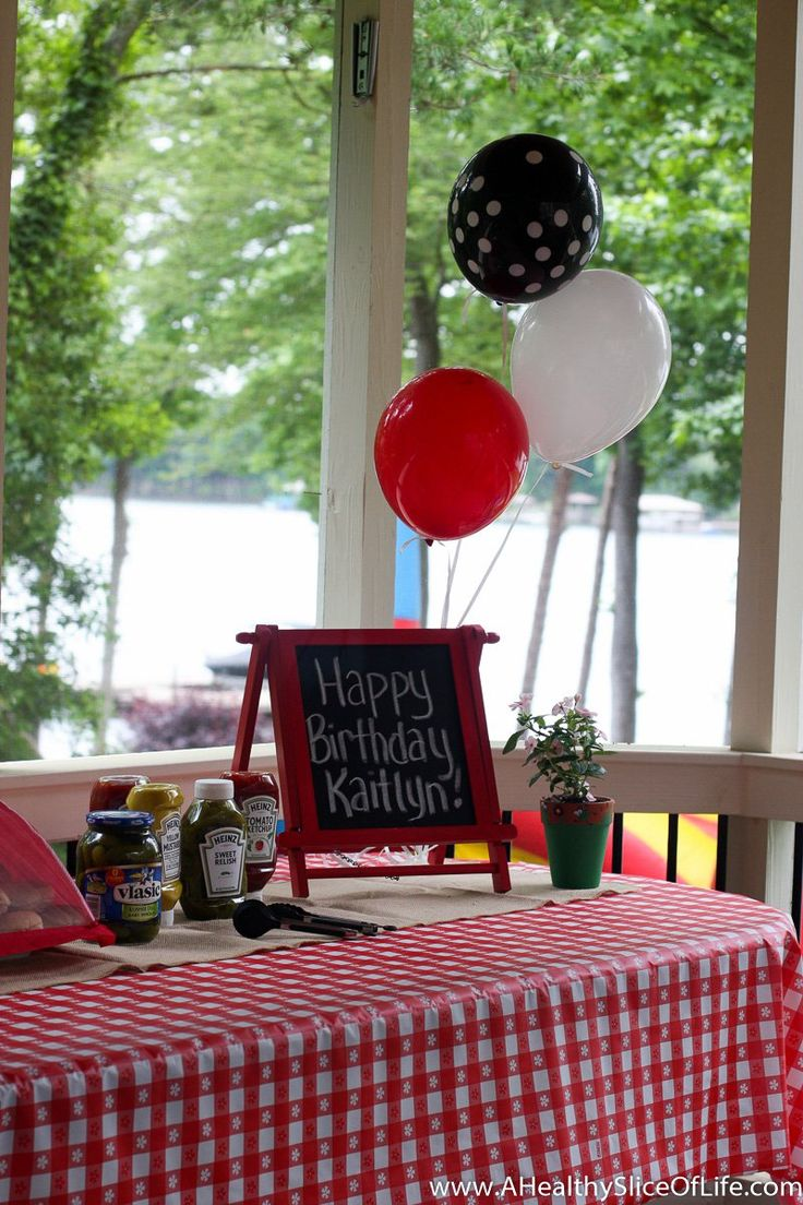 Kaitlyn's 3rd birthday featured a backyard cookout, a bounce house and fun for guests of all ages!