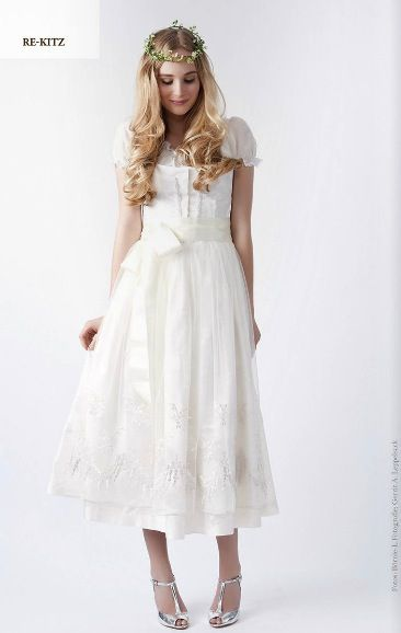In Austria the brides traditionally wore their best dirndl for the wedding. This one is so sweet!