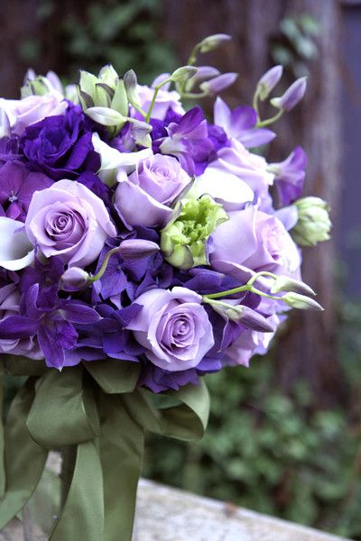 Mixed of cool water lavender roses, purple hydrangeas, purple dendrobium orchids, and purple lisianthus bouquet.