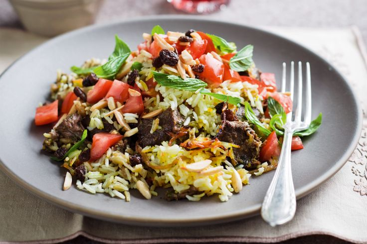 Curried lamb layered with saffron rice and fried onions makes for a biri-yummy bake.