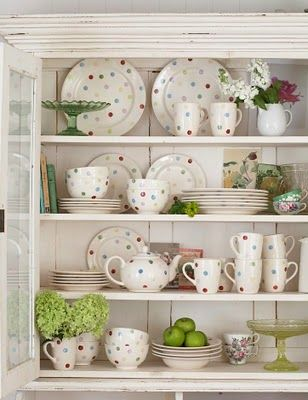 pretty colorful polka dot china in a hutch
