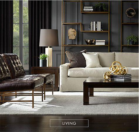 Sillon beige, sillones pequeños capitonados negros alfombra beige piso obscuro cortinas negras librero madera pared gris