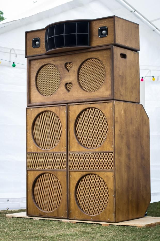 """Heritage HiFi speaker boxes, custom-built by Paul Axis (Huddersfield) for the touring exhibition that accompanies the One Love book, photographed at Huddersfield Carnival, Greenhead Park, 13 July 2013. The Heritage HiFi sound system is made up entirely of locally manufactured equipment: Vintage Fane 18"""" bass speakers, 15"""" mids, compression driver and bullet tweeters, as well as Matamp amplifiers and mixer, all made in West Yorkshire. Photo by Elliot Baxter."""