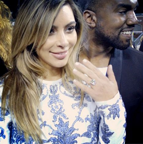 Kim Kardashian shows off her engagement ring from Kanye West at AT&T Park in San Francisco, CA.10-22-13