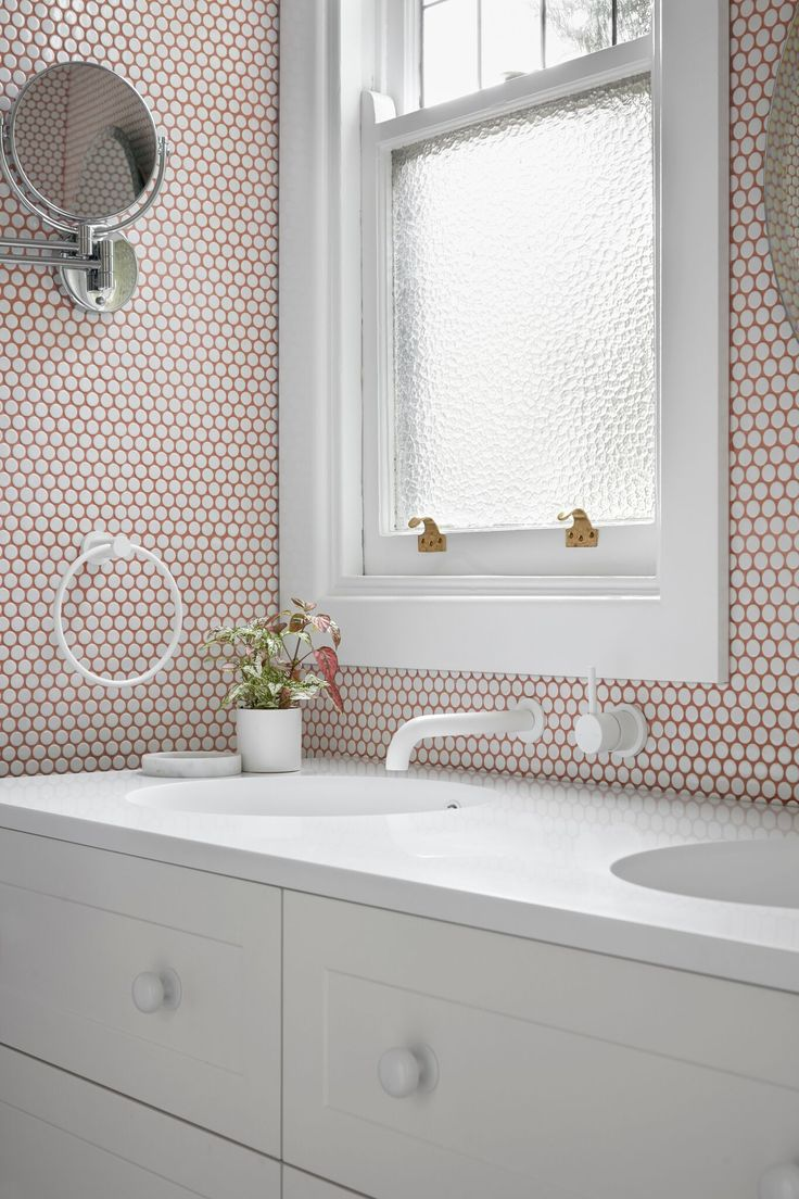 Showstopper bathroom with pink grout in our Maribyrnong home. Designed and built by smarterBATHROOMS+