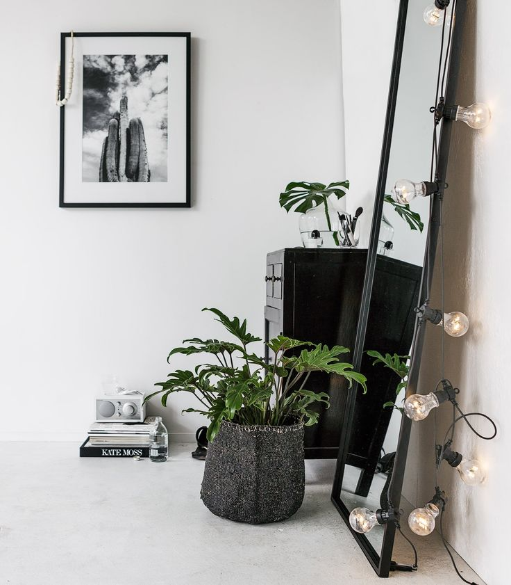 Jazz up a large, full-length mirror in your (bed)room by layering a string of black-wired carnival lights over the side. – Indie Home Collective