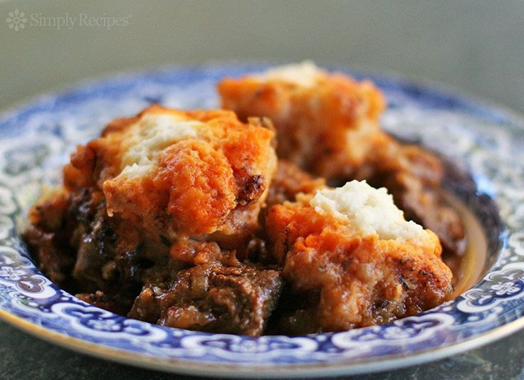 Beef Goulash with Dumplings ~ Beef goulash with light, fluffy dumplings.  Central European goulash, a beef stew with Hungarian paprika, onions, tomato paste, cubed chuck roast, herbs and stock. ~ SimplyRecipes.com