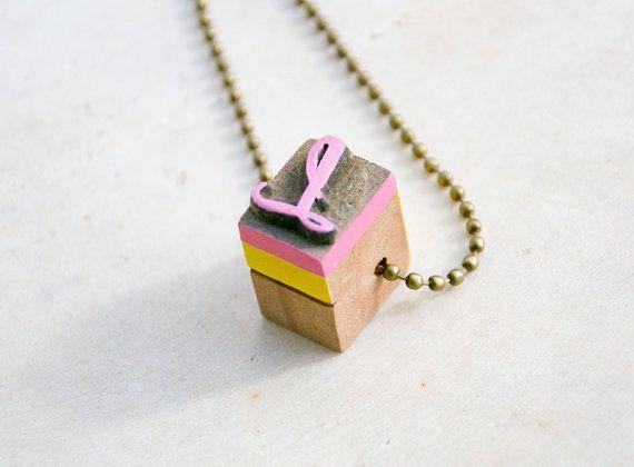 Vintage wooden typographic necklace.