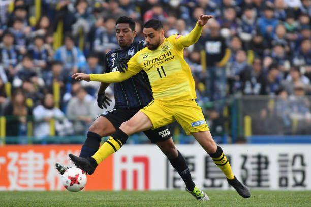 Diego Oliveira of Kashiwa Reysol and Fabio of Gamba Osaka compete for the ball during the J.League J1 match between Kashiwa Reysol and Gamba Osaka at Hitachi Kashiwa Soccer Stadium on March 5, 2017 in Kashiwa, Chiba, Japan.