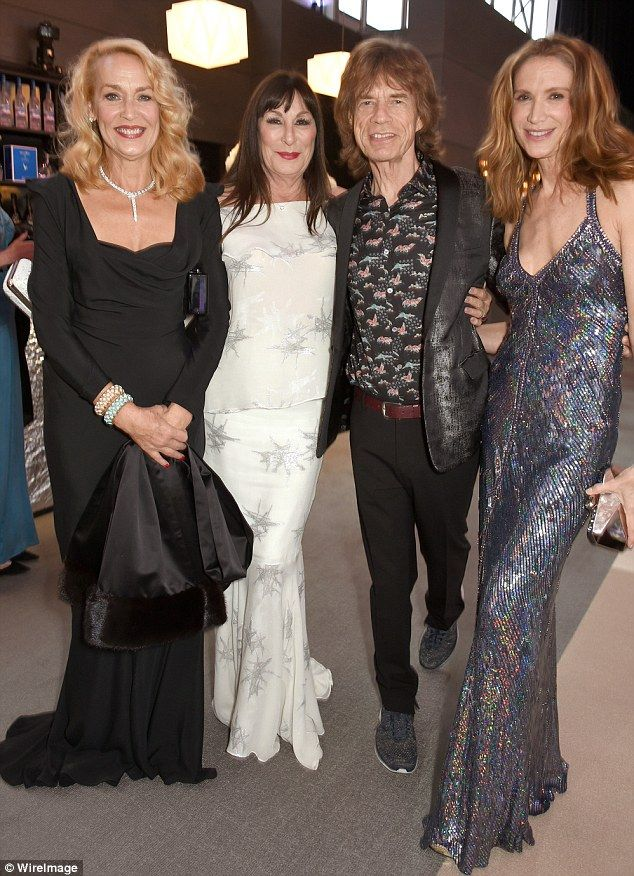 Happy reunion: Sir Mick and ex-wife Jerry were in high spirits as they posed for photos alongside actresses Anjelica Huston and Kelly Lynch