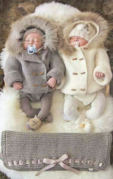Knitted winter outfits for twin babies.