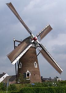 An old Dutch grain grinding windmill
